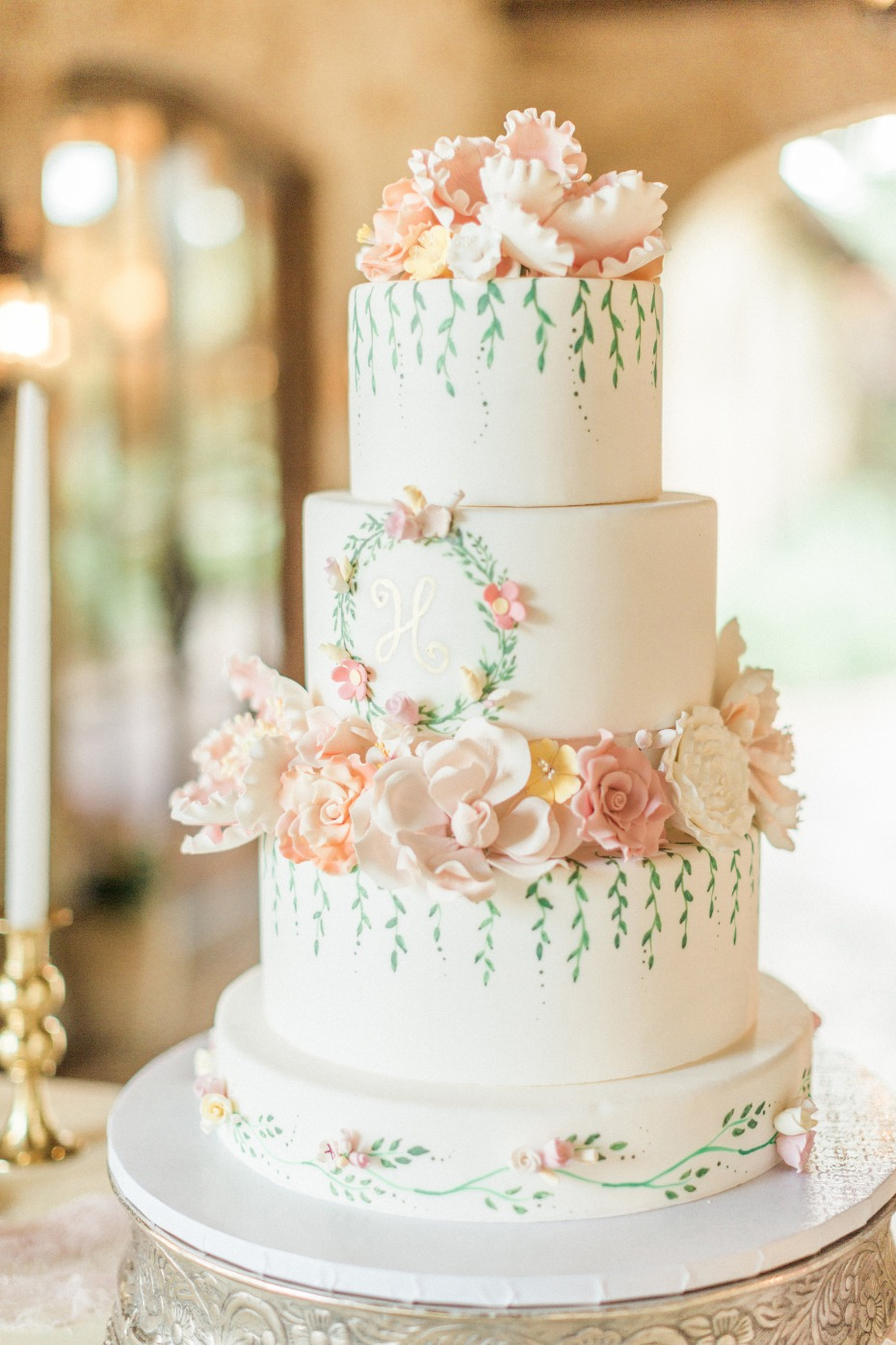 blush flower topped wedding cake