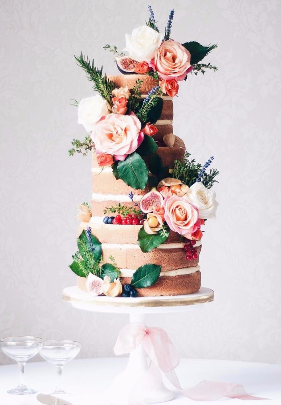 naked wedding cake with flowers and fruit
