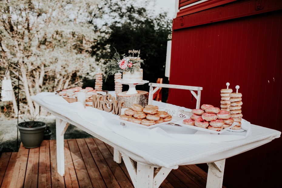 dessert table with cake and donuts