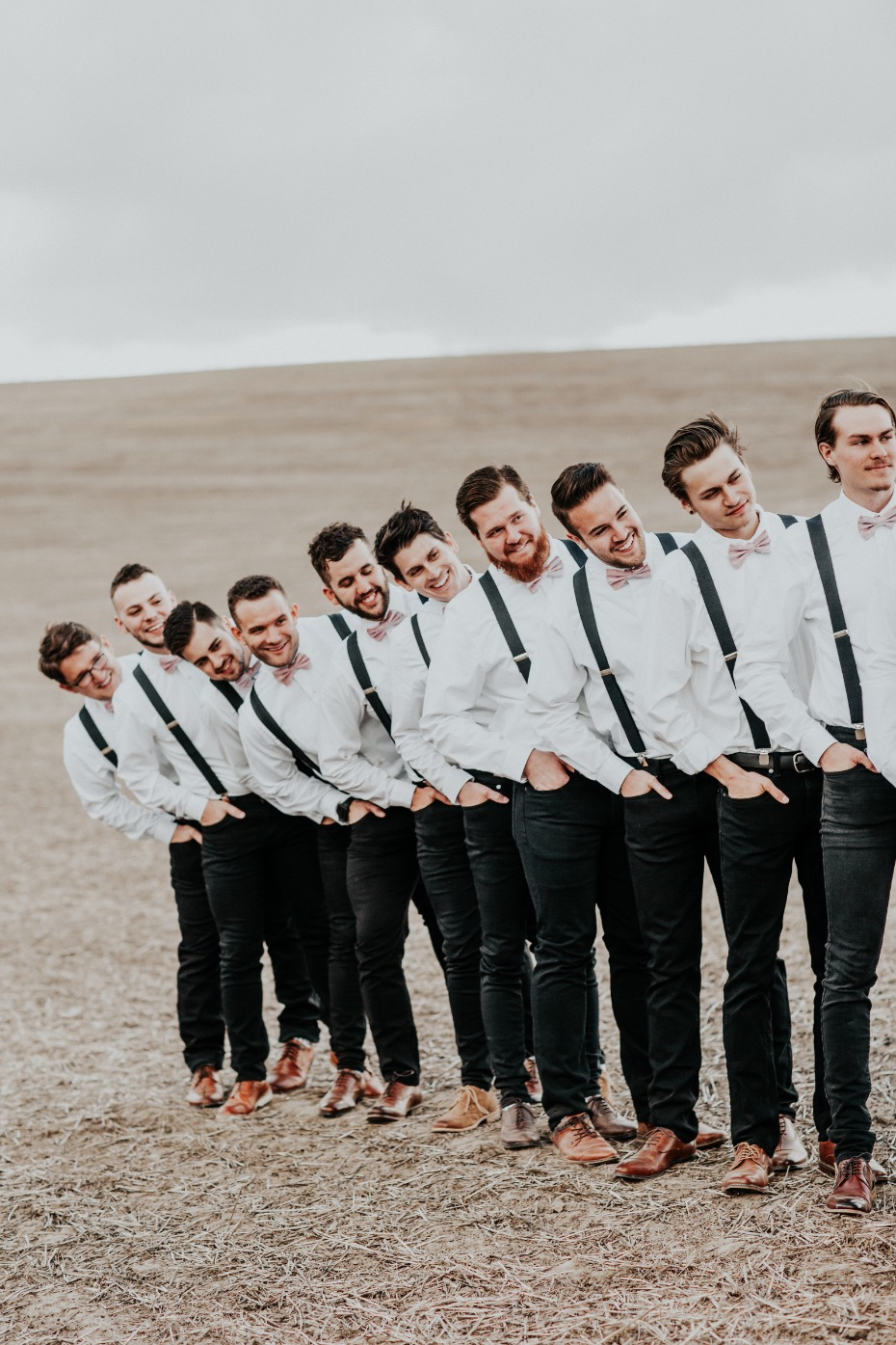 grooms men trying to get a good look