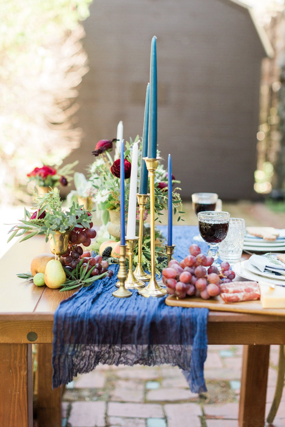 Italian inspired tablescape with blue candles