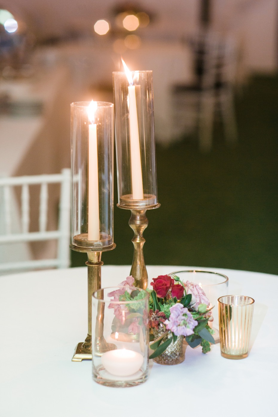 Simple yet elegant centerpiece with candles and florals