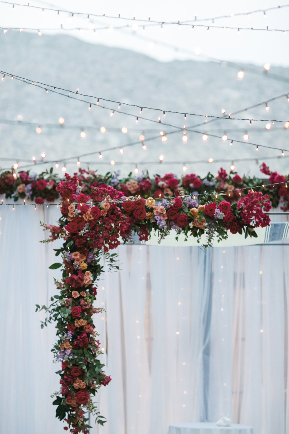 Floral arch with bistro lights