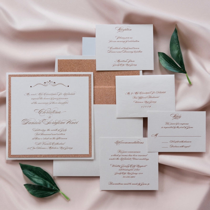 Rose gold glitter ink wedding invitation suite with rhinestone details.
