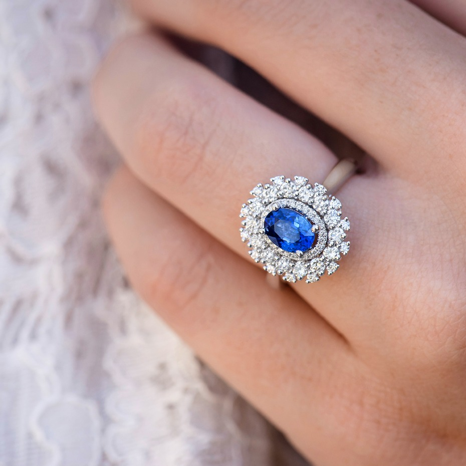 halo engagement ring with blue sapphire center