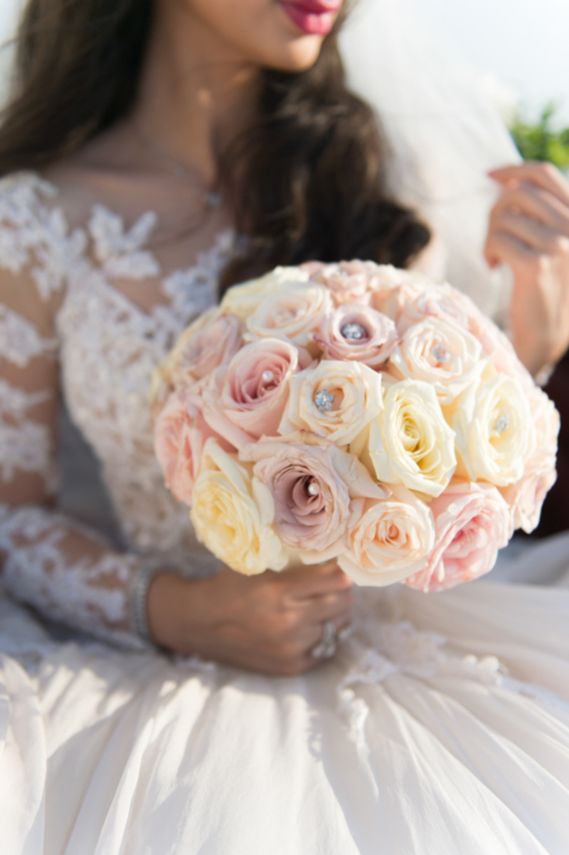 Luxurious bridal bouquet with diamond details. See her story