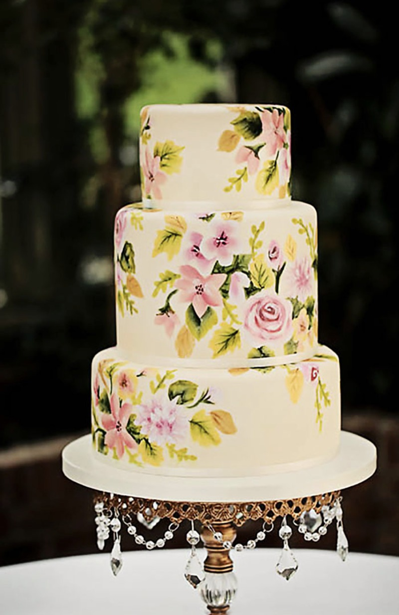 Hand painted tiered wedding cake on gold chandelier ball pedestal base cake stand by Opulent Treasures