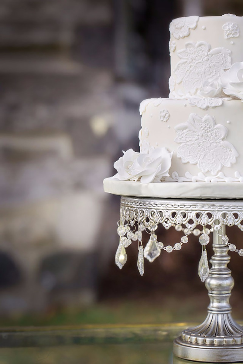 Antique Silver Chandelier Pedestal Cake Stand created by Opulent Treasures. Wedding Cake Ideas: White Wedding Cake with Lace Applique
