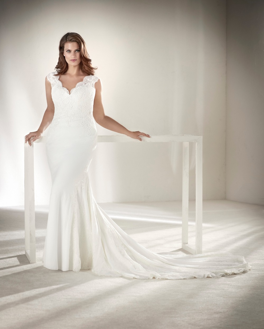 Elegant and modern mermaid plus size wedding gown from Pronovias