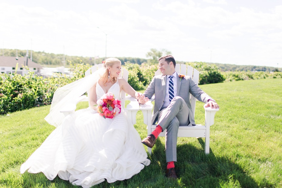 cute bride and groom lounging on their wedding day