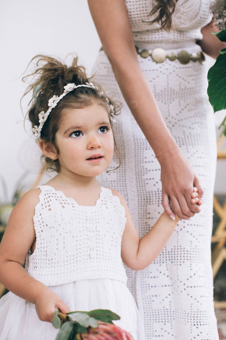 cute flower girl in white and faux flower halo