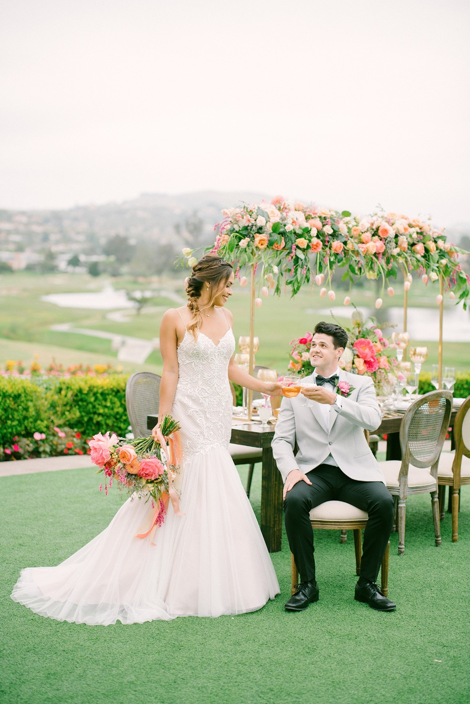 bride and groom at their spring garden party wedding