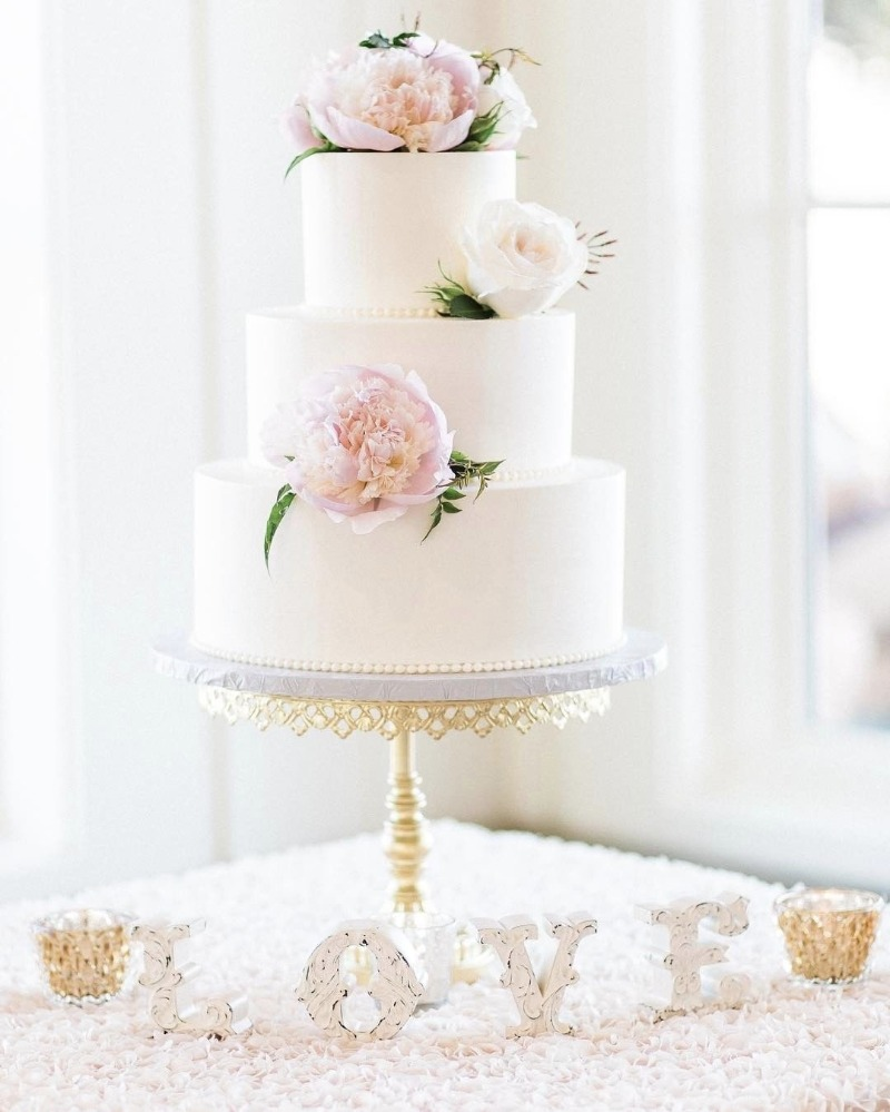 White Tiered Wedding Cake with fresh blush pink peonies on gold Cake Stand created by Opulent Treasures