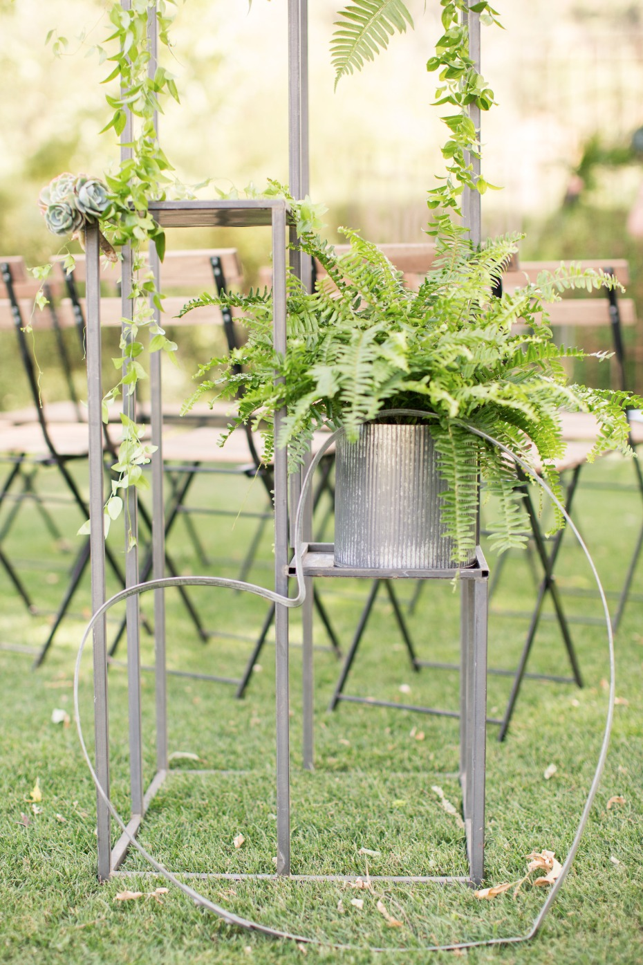 industrial metal and greenery wedding decor
