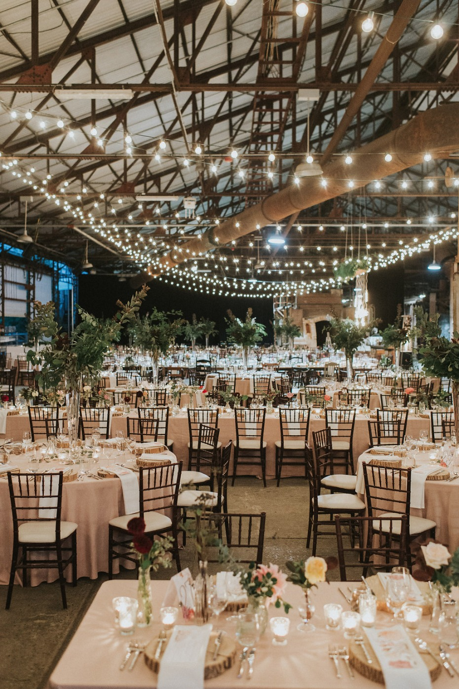 huge and intimate wedding reception with tons of string lights