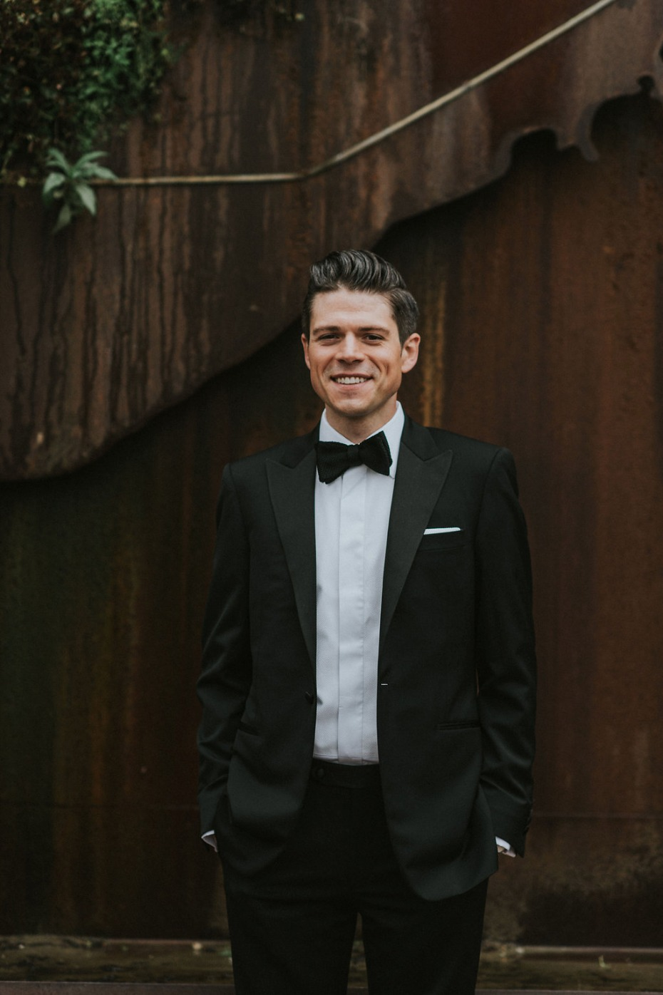 groom in black tie style