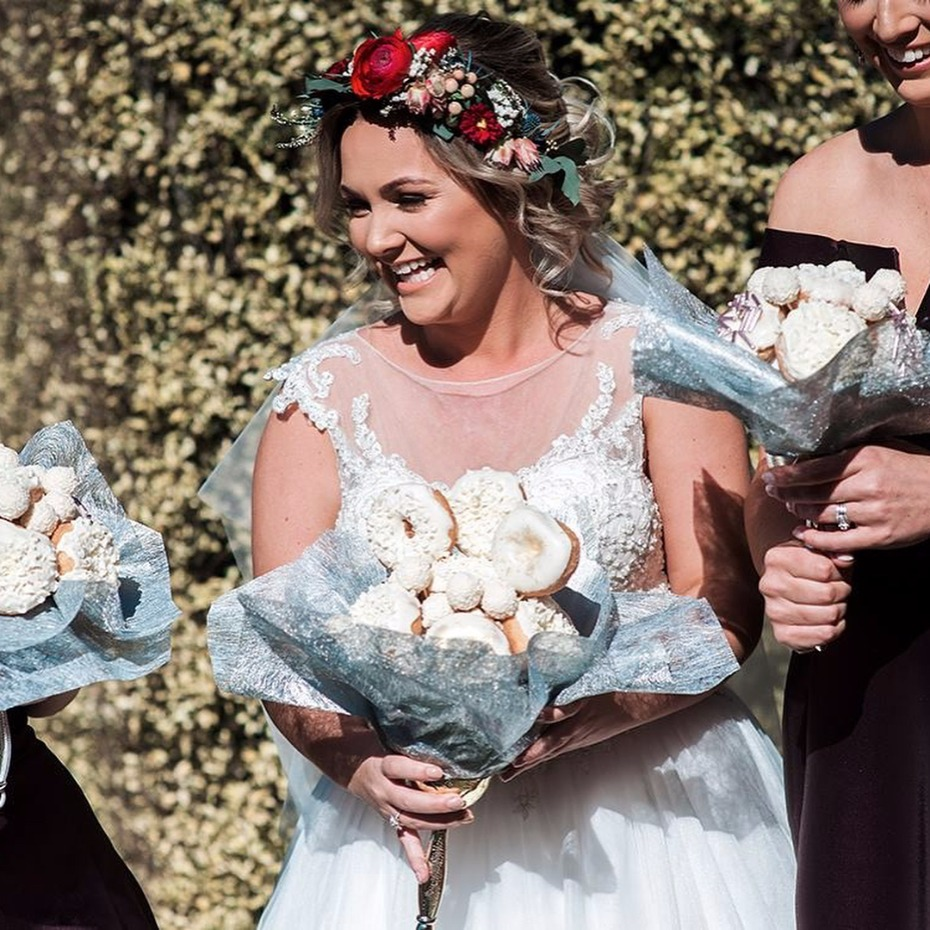 bride with donut bouquet
