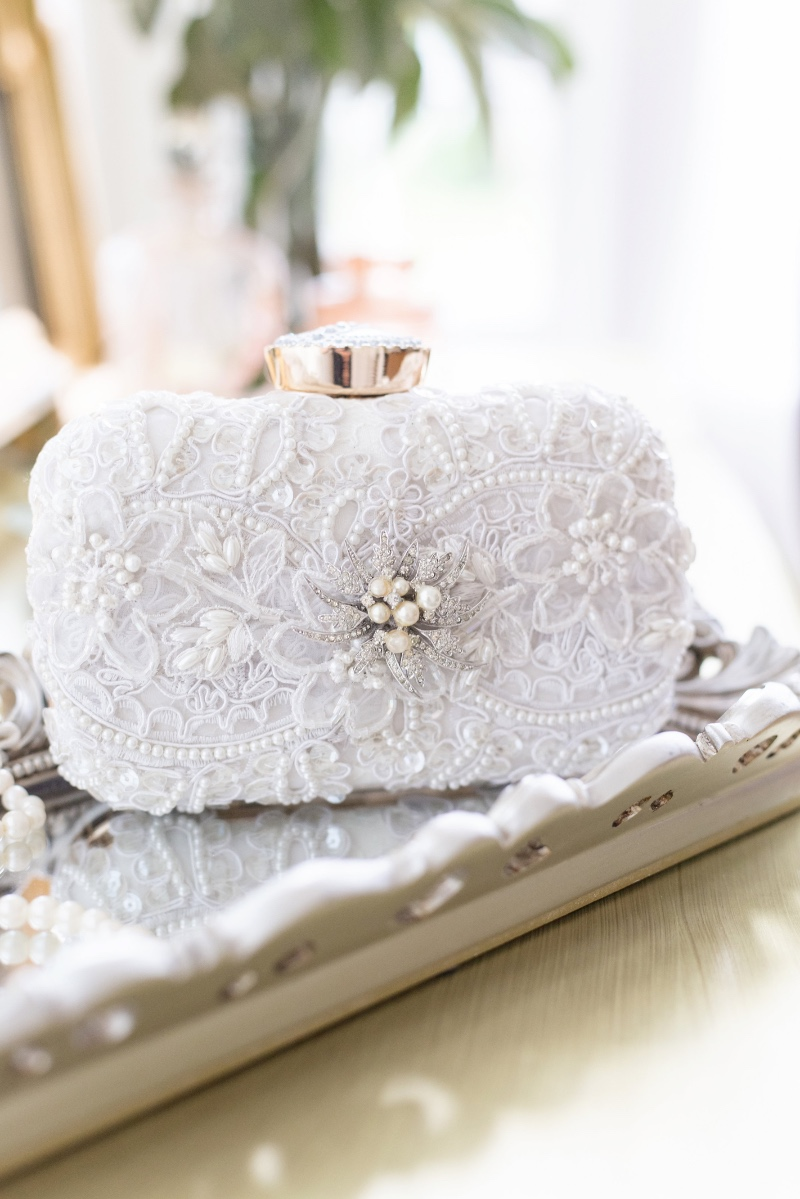 Dreamy and romantic ivory detail with a touch of a vintage jewel.