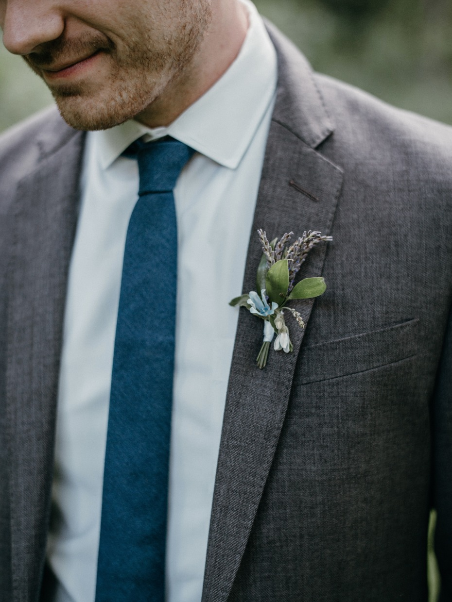 Blue tie and grey suit