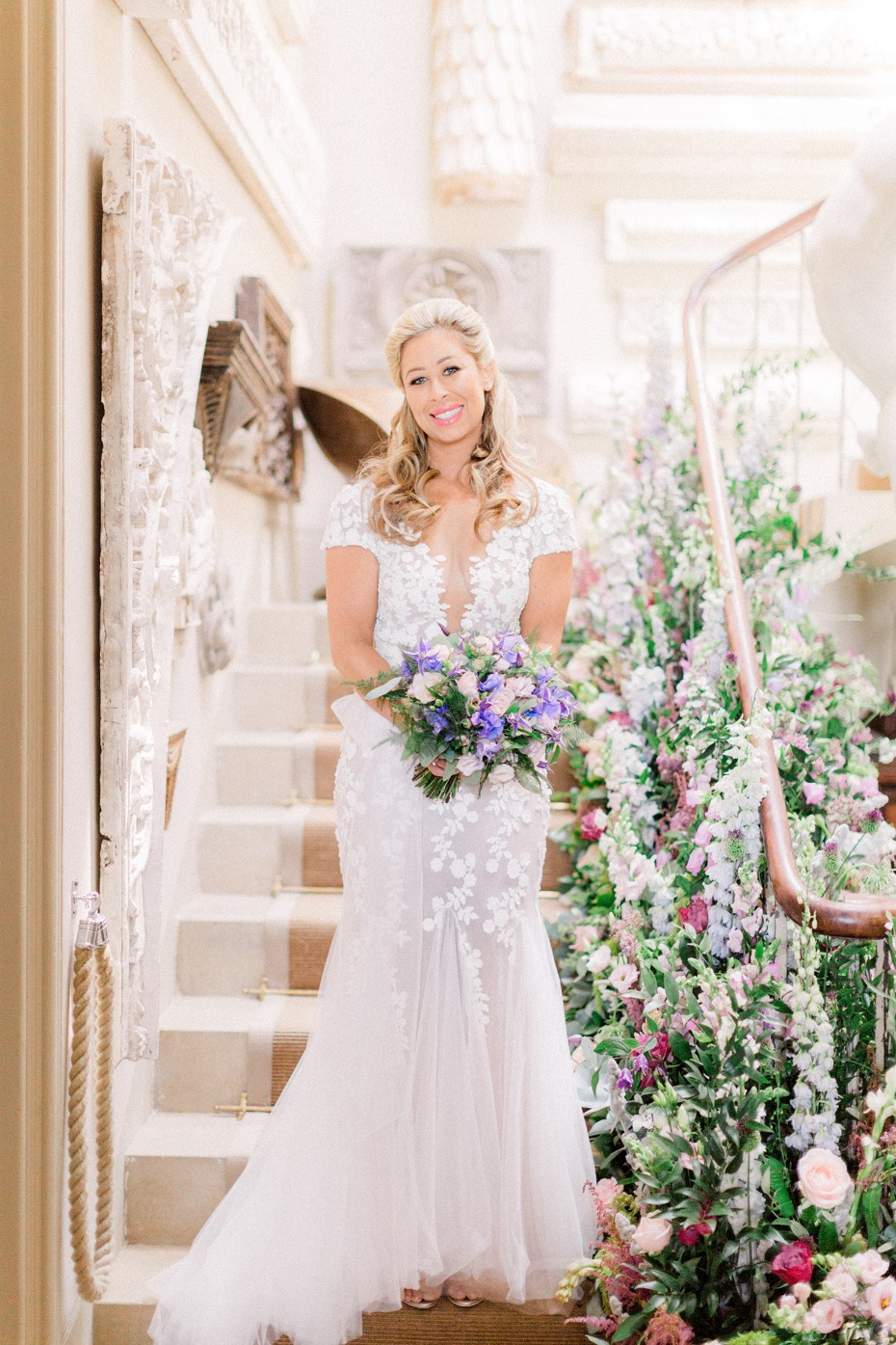 bride descending the floral stairs