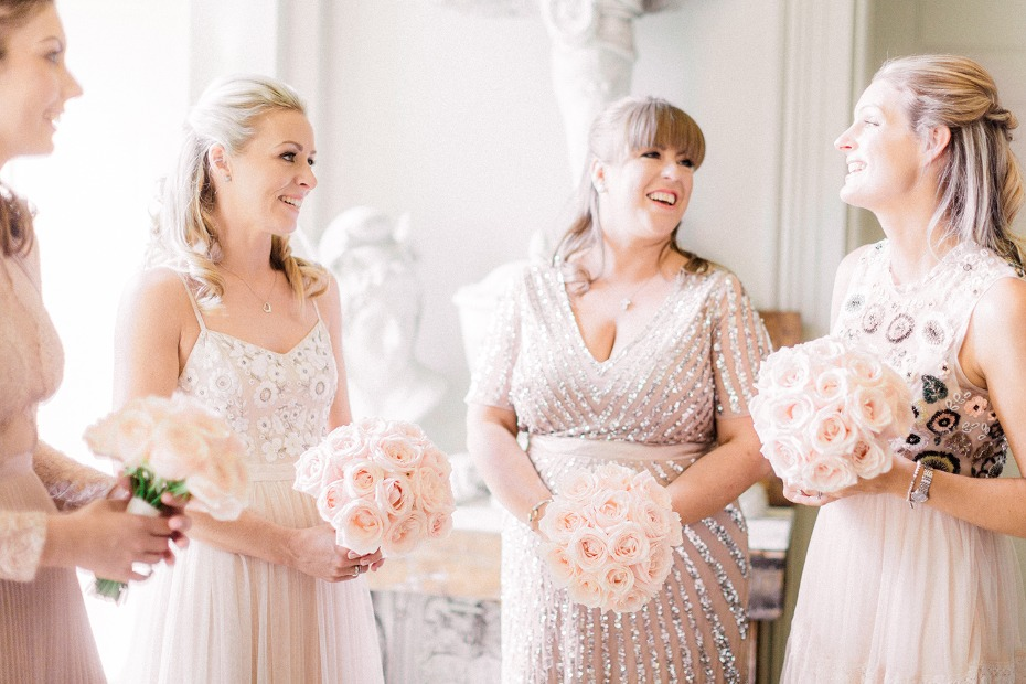 Bridesmaids in mix and match blush dresses