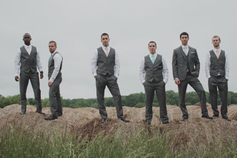 groom and his groomsmen in matching grey