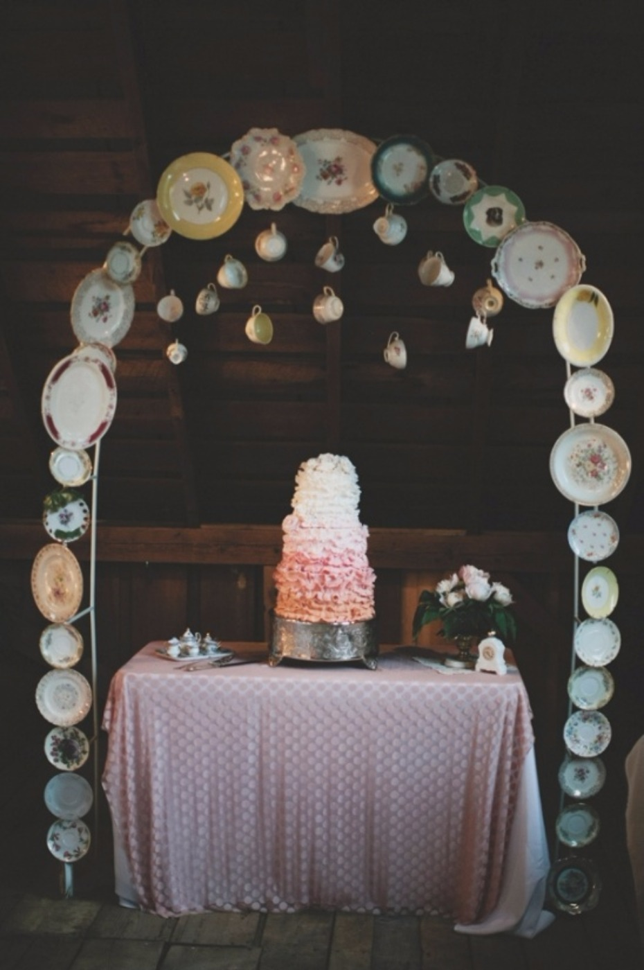 whimsical tea cup and saucer cake table arch