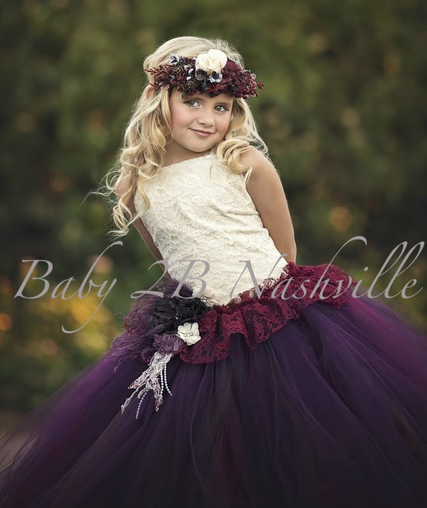 With rich plum, wine and chocolate and a touch of bridal lace this flower girl dress would be perfect in your fall wedding.