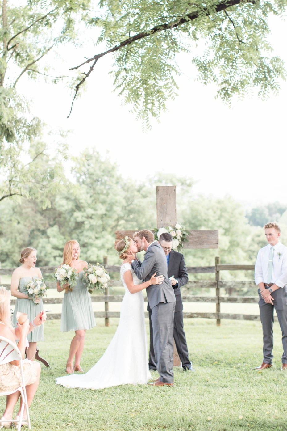 Wedding ceremony idea - get married under a tree in front of a wooden cross