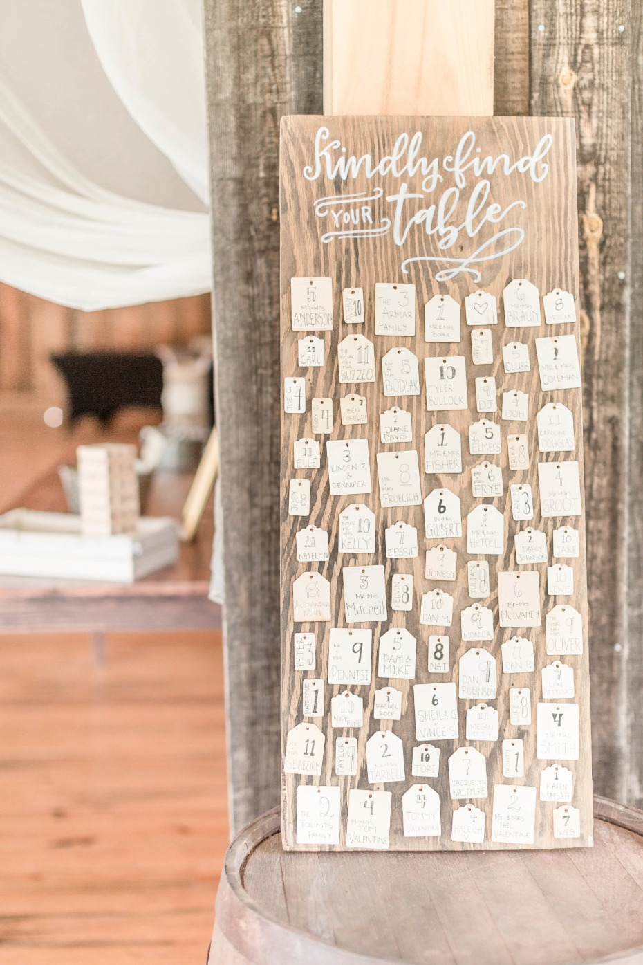 hand written seating assignments on mismatched hang tags