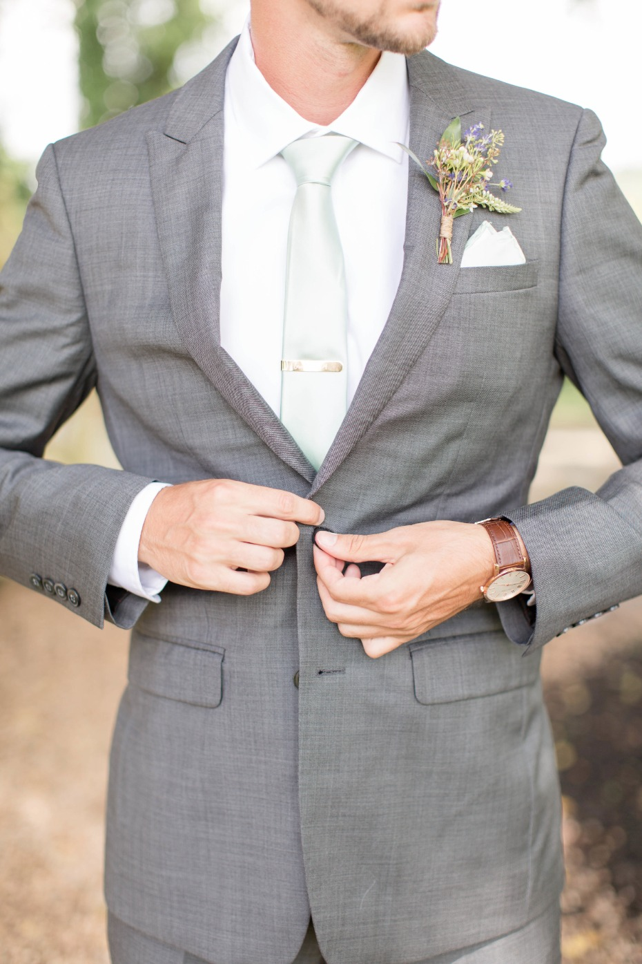 gray and mint groom look