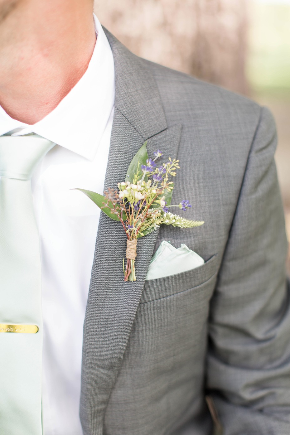 purple and mint rustic boutonnière wrapped in twine
