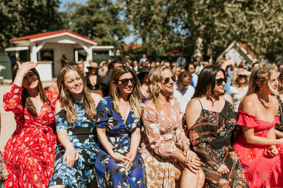 mismatched bridesmaids in floral dresses