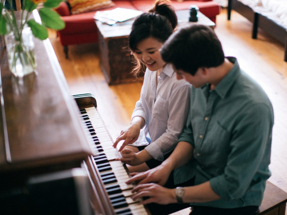 playing a little piano for your engagement shoot