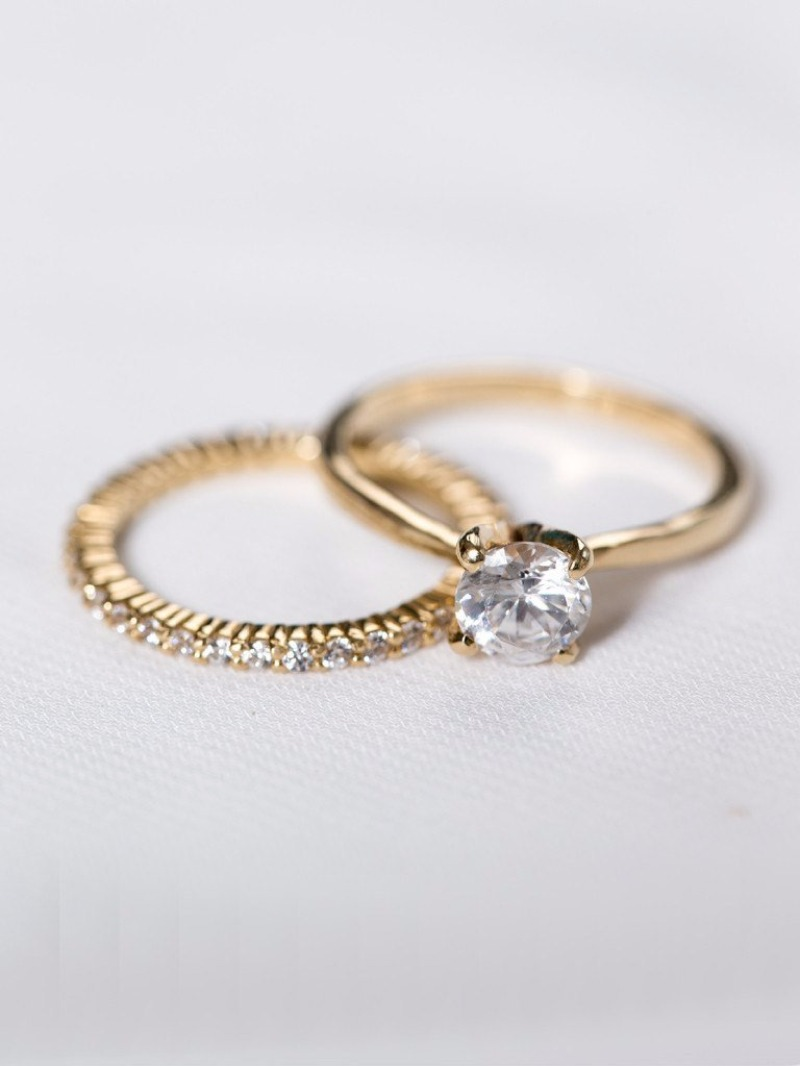 The classic Madeleine Ring and her wedding band match.