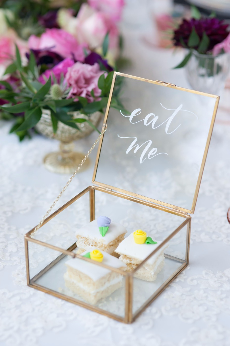 """Eat me"" box of treats for an Alice in Wonderland wedding"