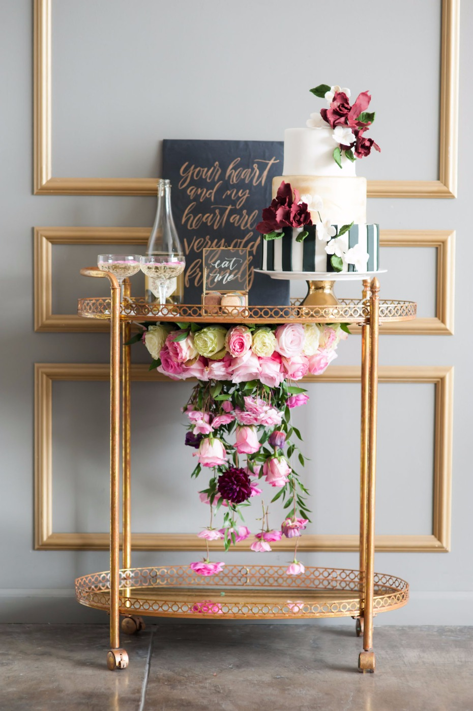 CAKE bar cart with a floral chandelier!