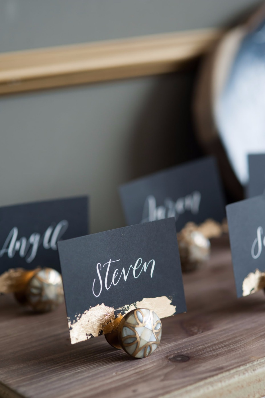 Black escort cards with gold foil