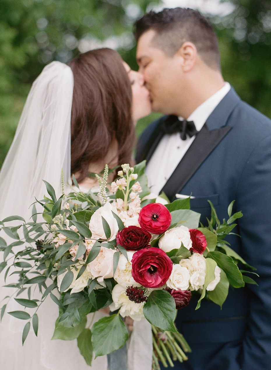 wedding bouquet and wedding kiss