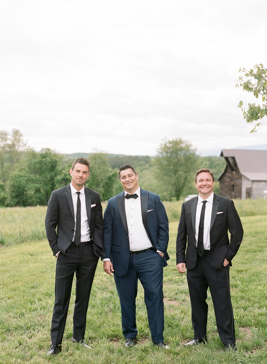 groom in navy and groomsmen in classic blac