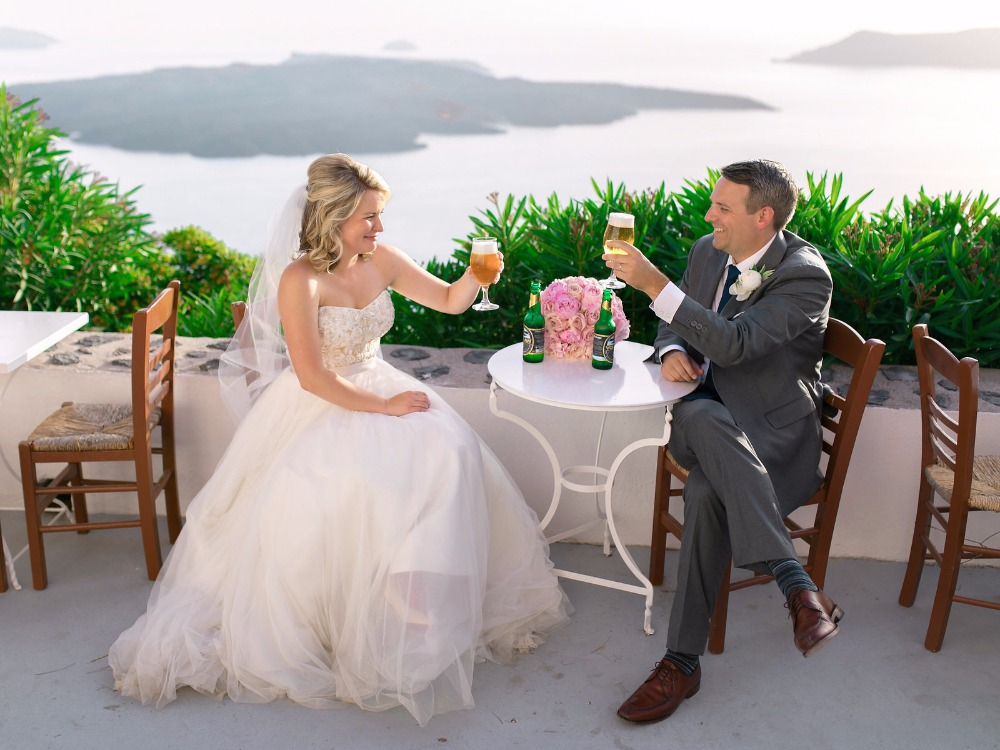 Cheers to the newlyweds in Santorini