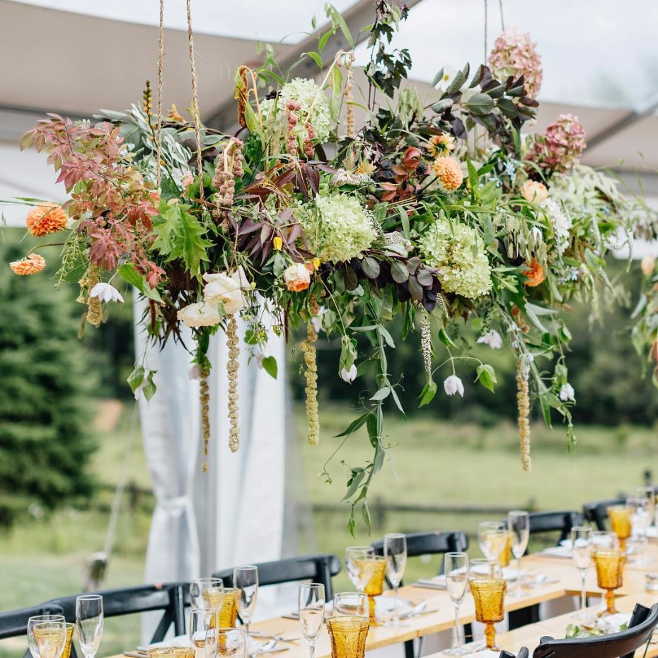 hanging flowers at an outdoor wedding