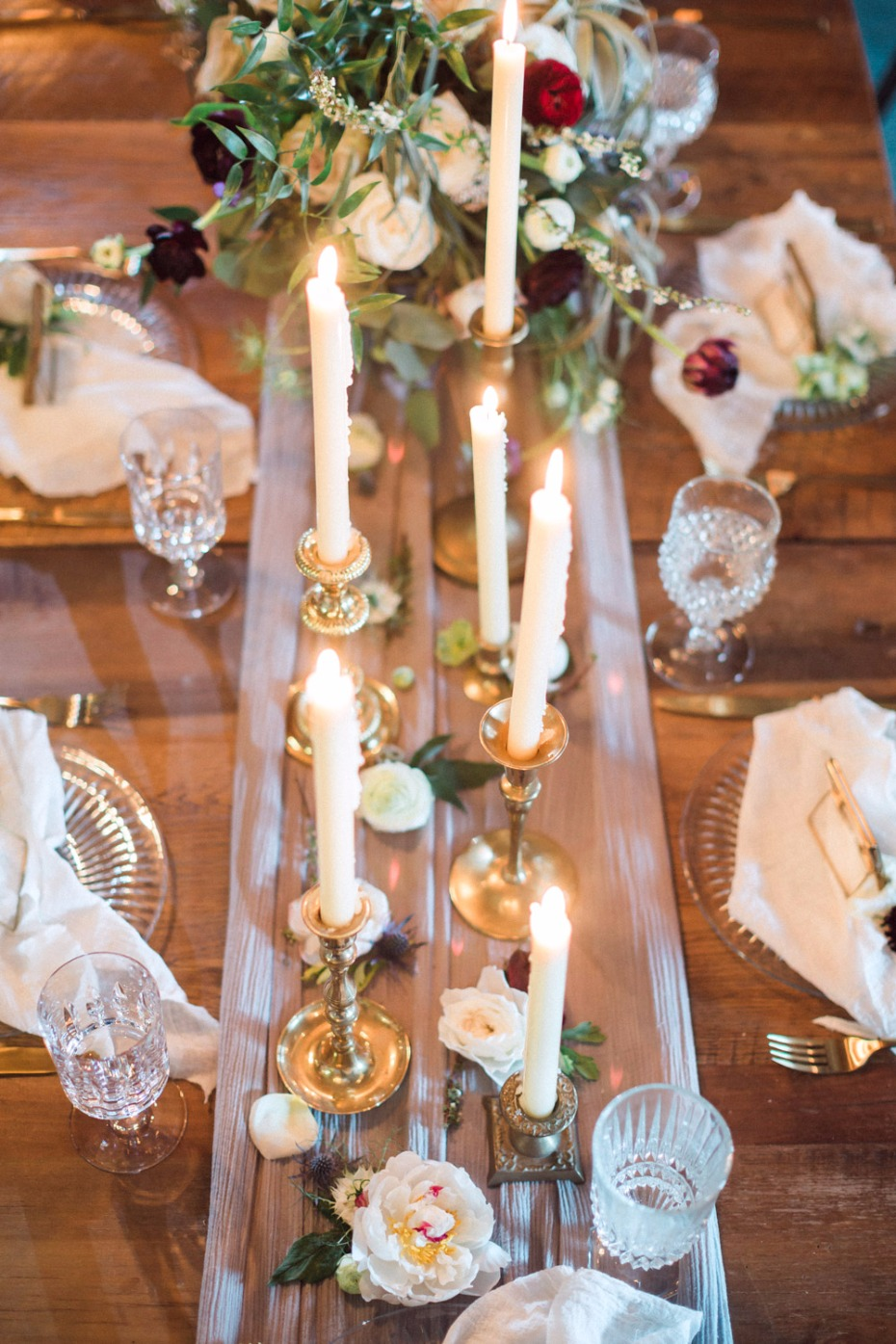 Tapered candle centerpiece with loose florals