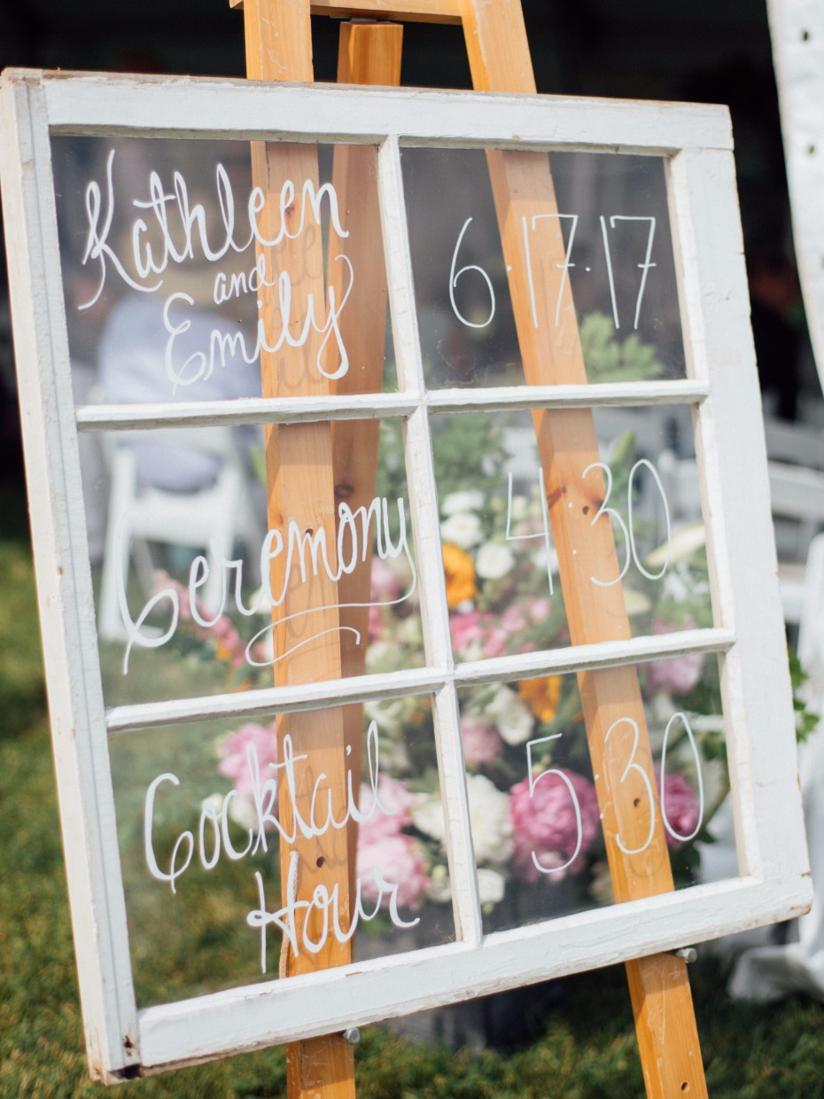 rustic wedding sign on a window