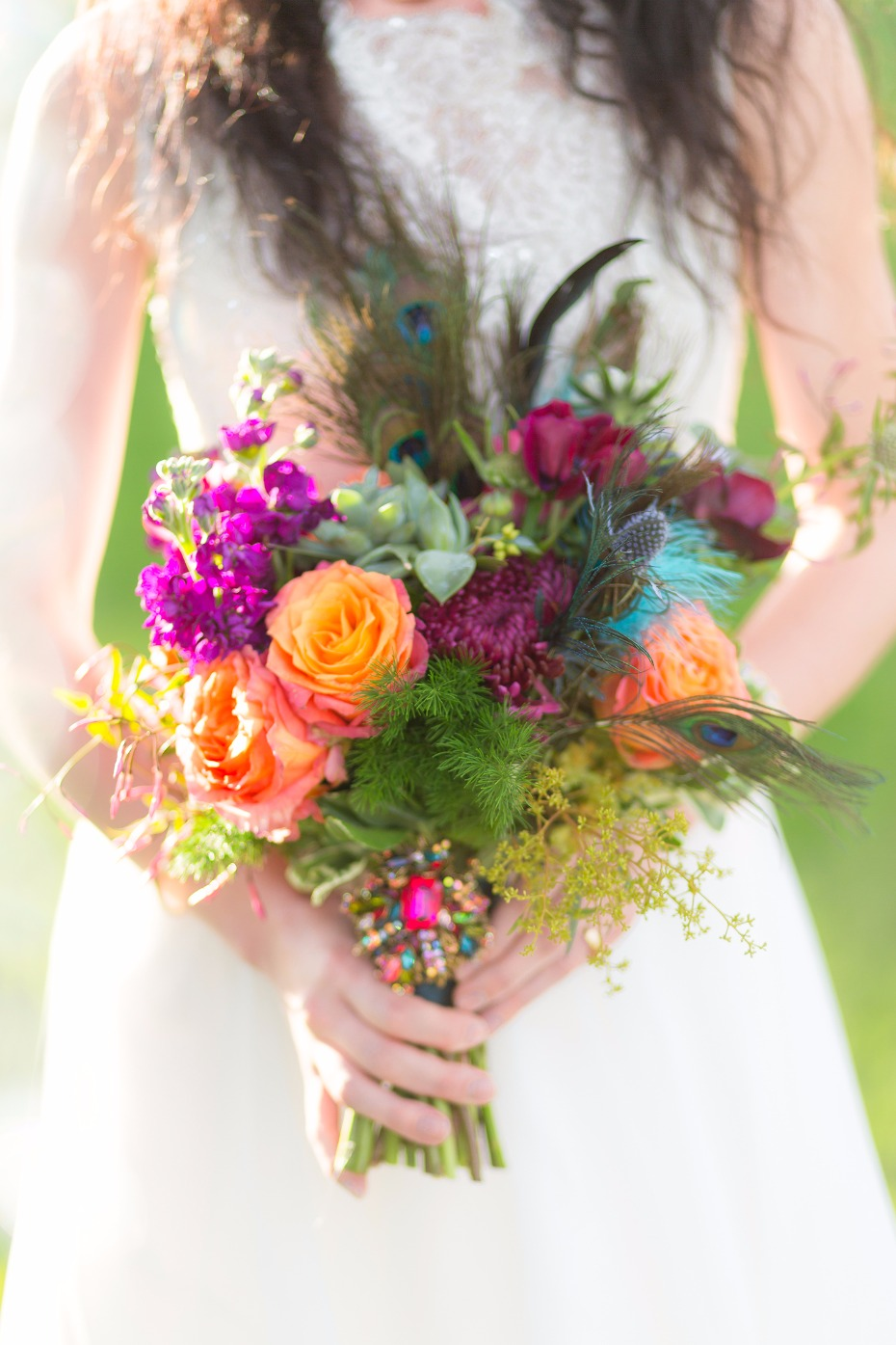Jewel toned bouquet with peacock feathers