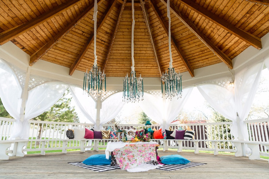 Jewel toned seating area for the bride and groom