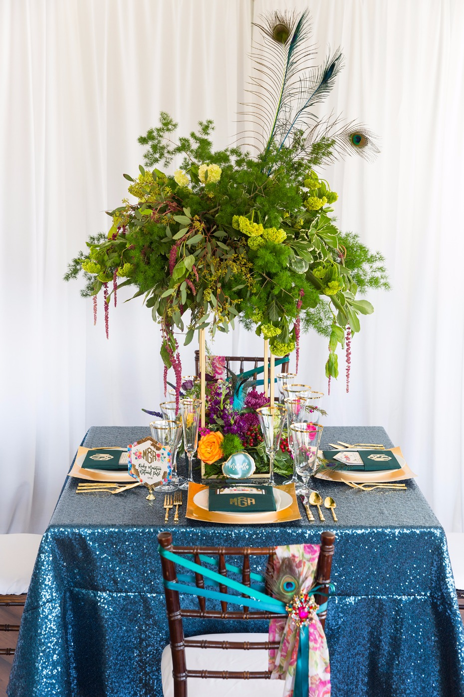 Peacock inspired table decor with gold