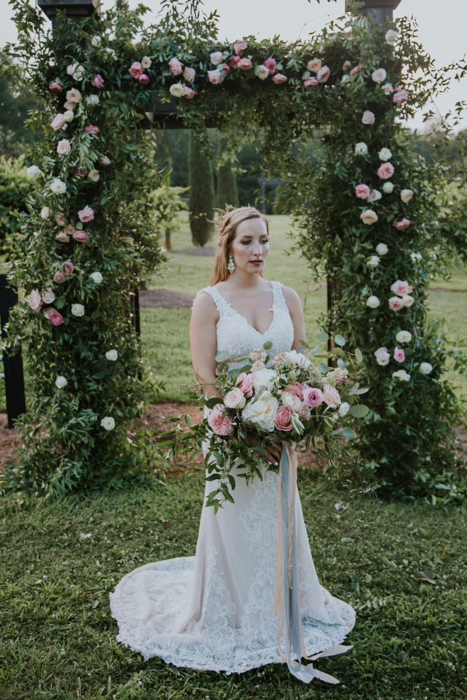 romantic rose covered wedding arch