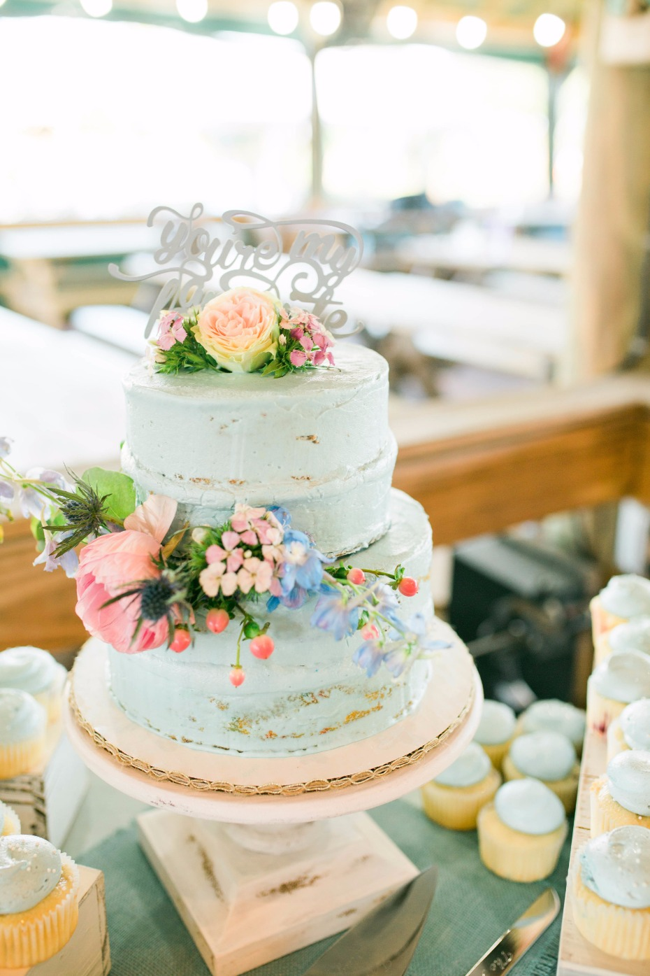 blue frosted wedding cake