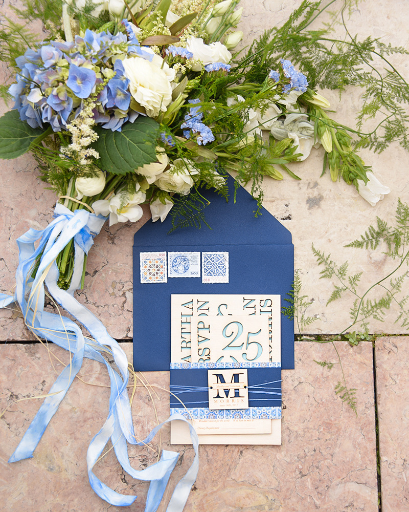 Wooden engraved wedding invitation in blue